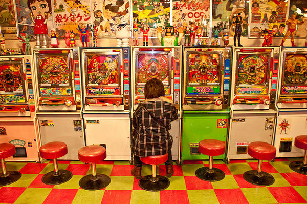 japanese video game kid in a vintage Tokyo arcade