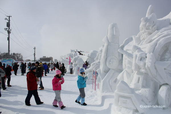 kids enjoying japanese snow festival