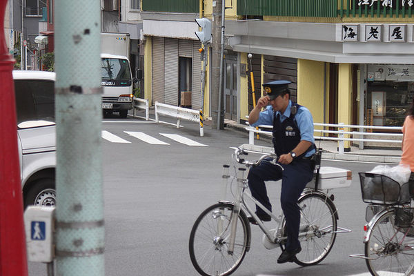 police in japan on bicycle